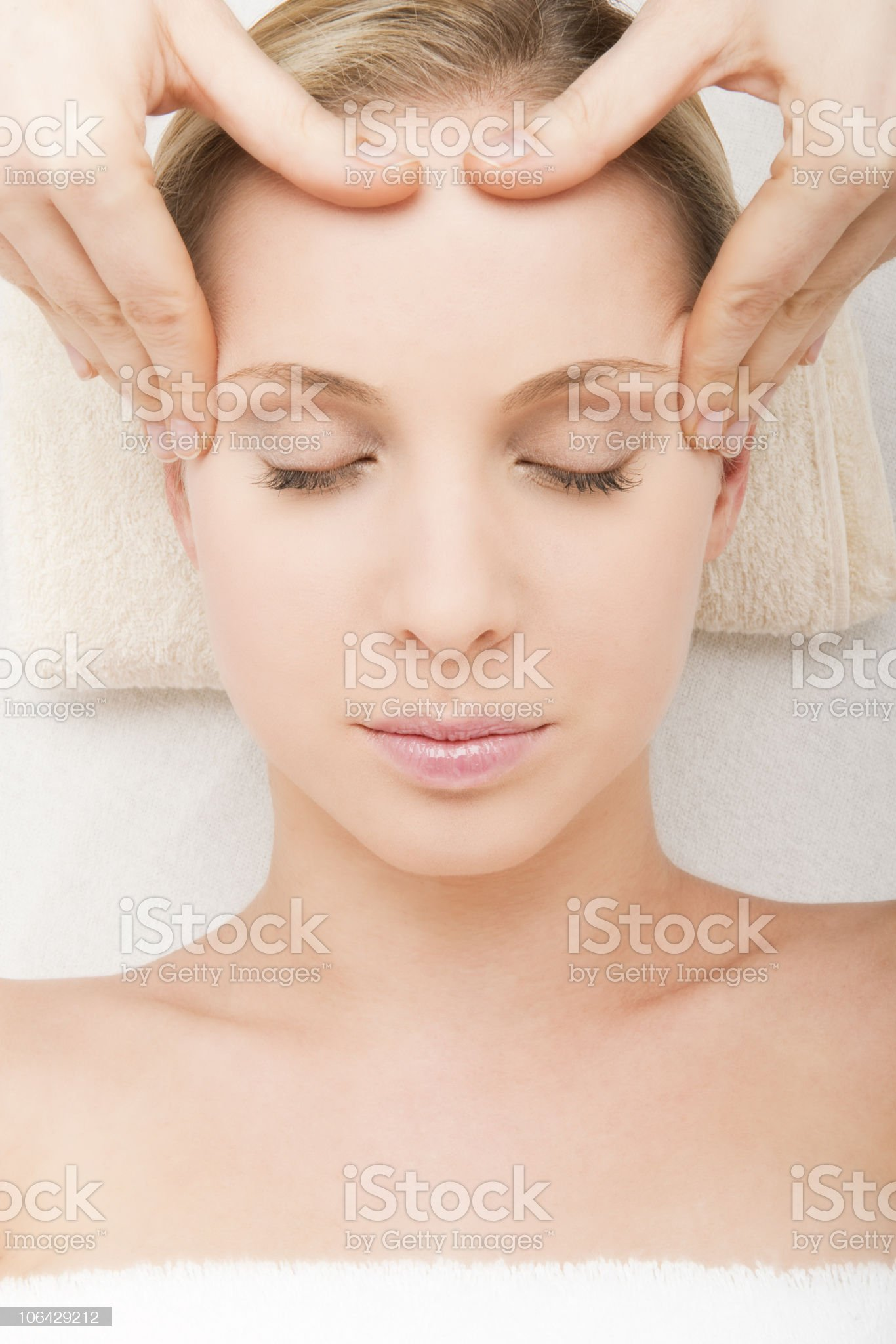 Woman comfortably receiving head massage royalty-free stock photo