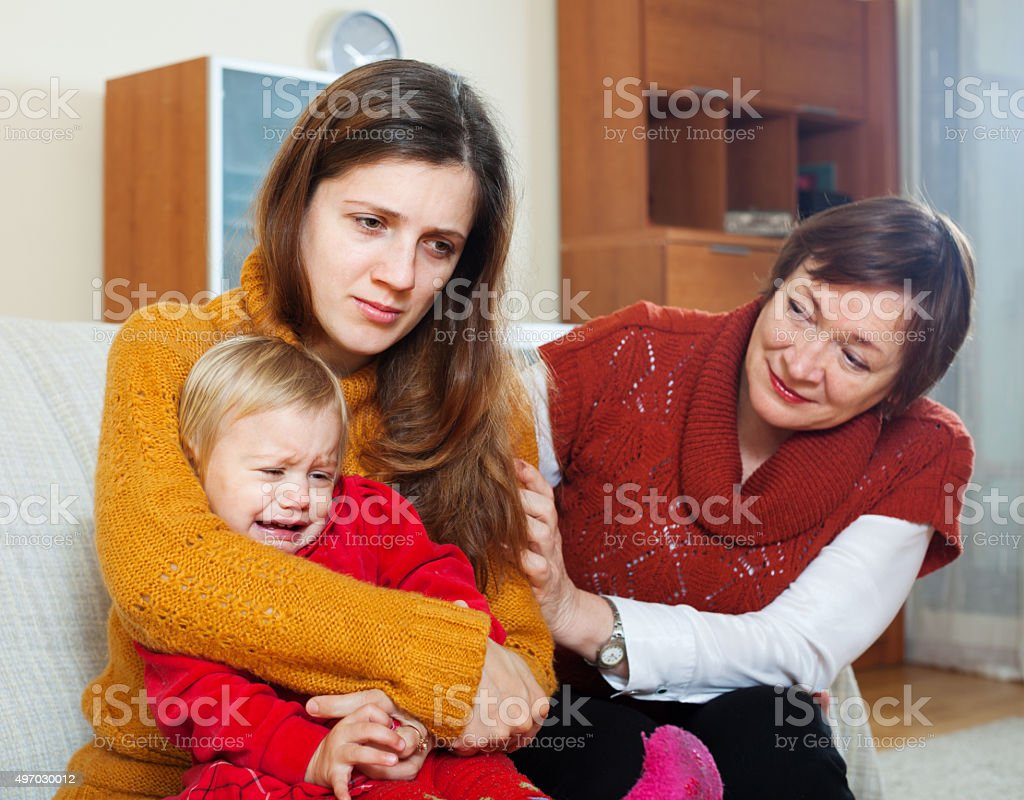 woman comforting adult daughter with baby stock photo
