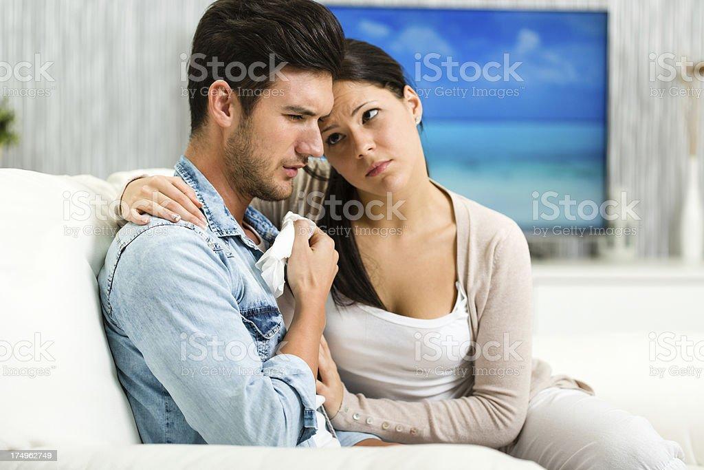 Woman comforting her boyfriend royalty-free stock photo