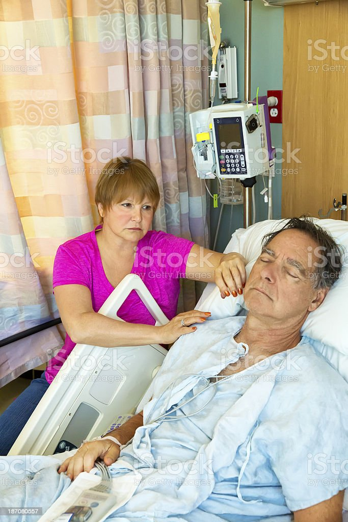 Woman comforts her husband in the hospital. royalty-free stock photo