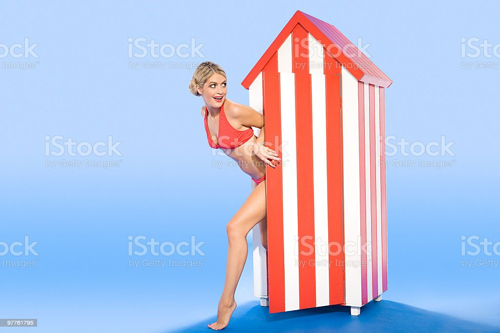 Woman coming out of beach hut royalty-free stock photo