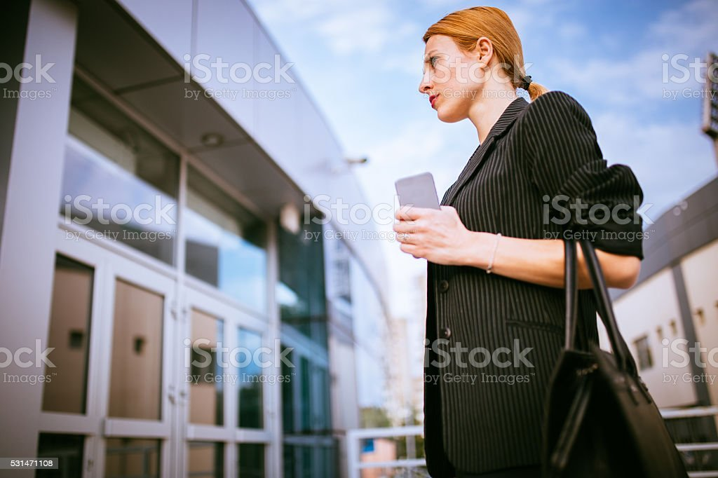 Woman coming to work stock photo
