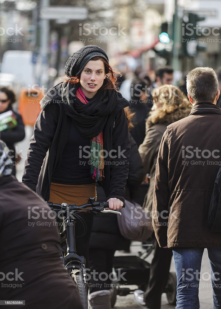 Woman Commuter Cycling on Crowded Berlin Street royalty-free stock photo