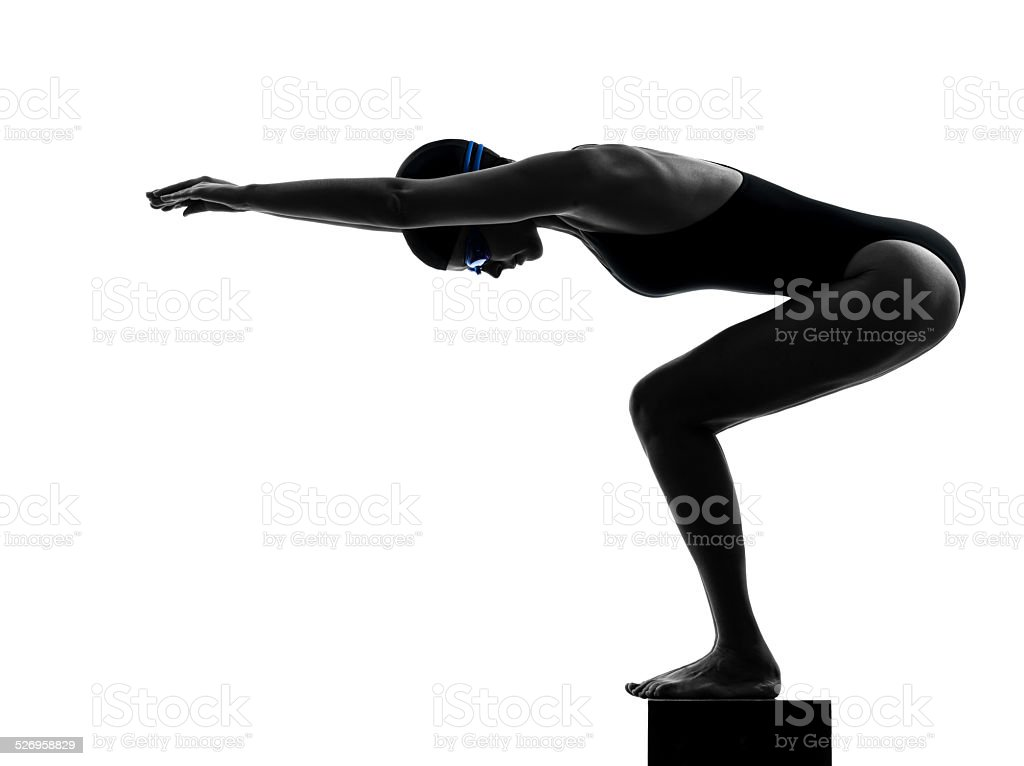 woman competition swimmer on starting silhouette stock photo
