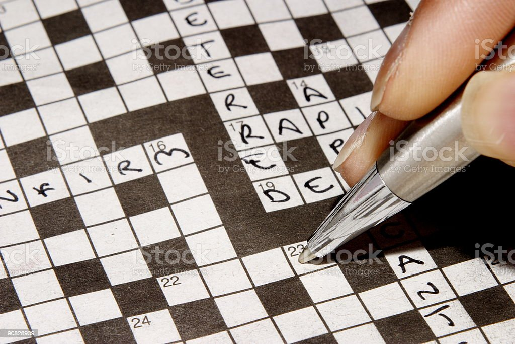Woman completing crossword stock photo