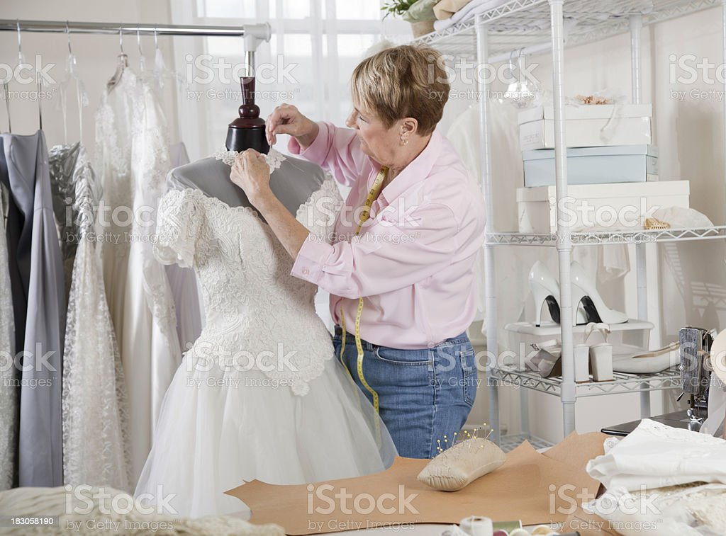 Woman Concentrating on Sewing royalty-free stock photo