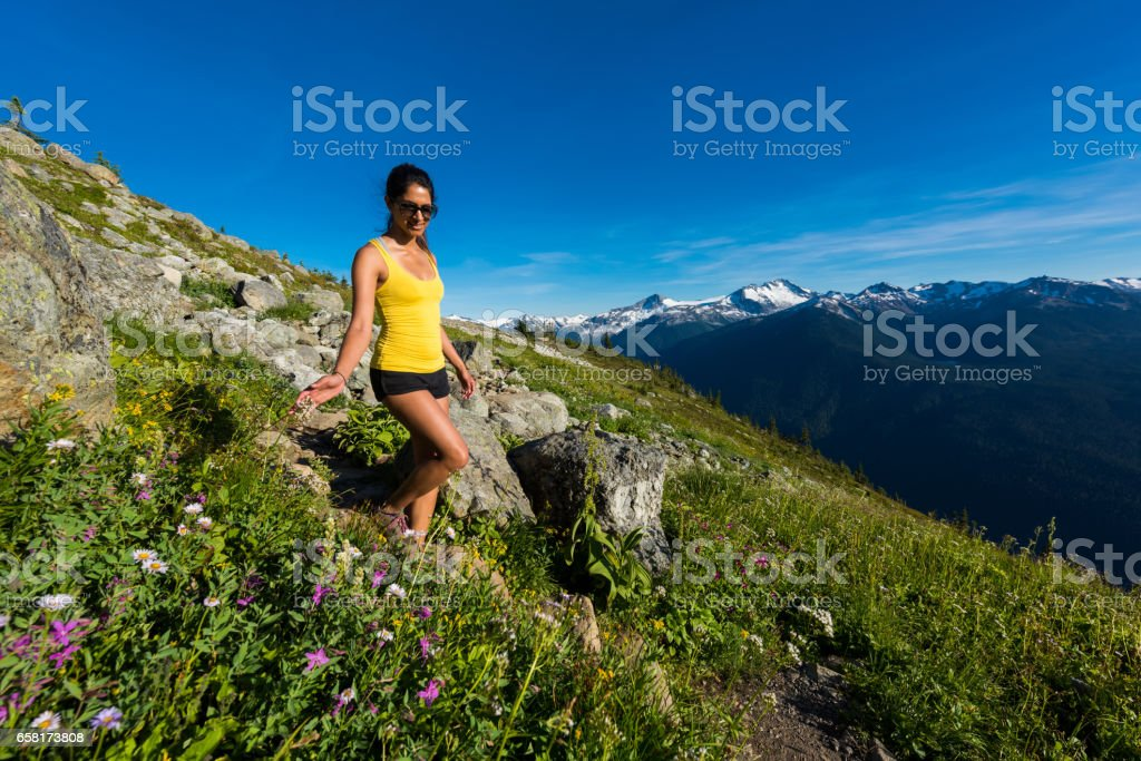 Woman connected with nature in the mountains stock photo