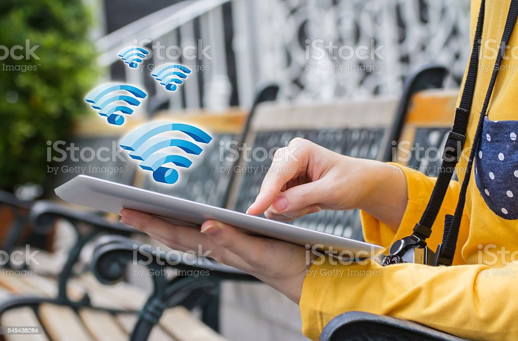 Woman connecting to Wifi stock photo