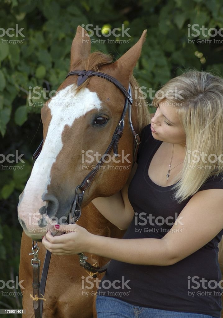 Woman Connecting with her horse, Therapy stock photo