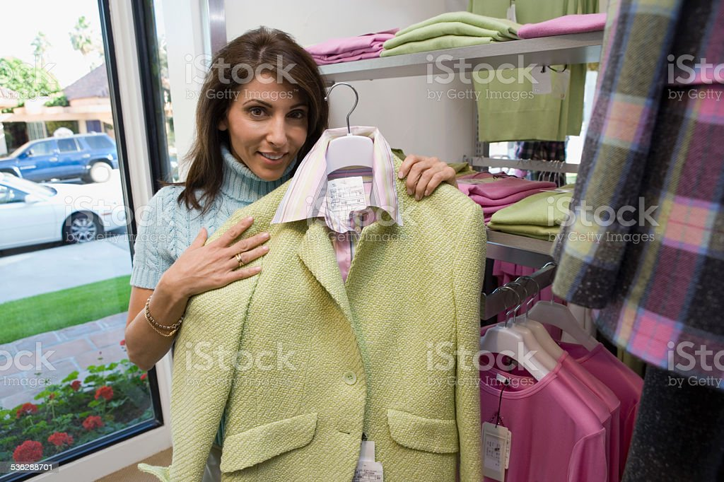 Woman Considering Clothes Outfit stock photo