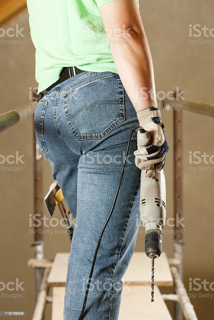 Woman Construction worker with hand drill royalty-free stock photo