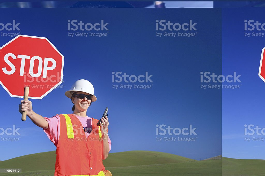 Woman Construction Worker with Stop Sign stock photo