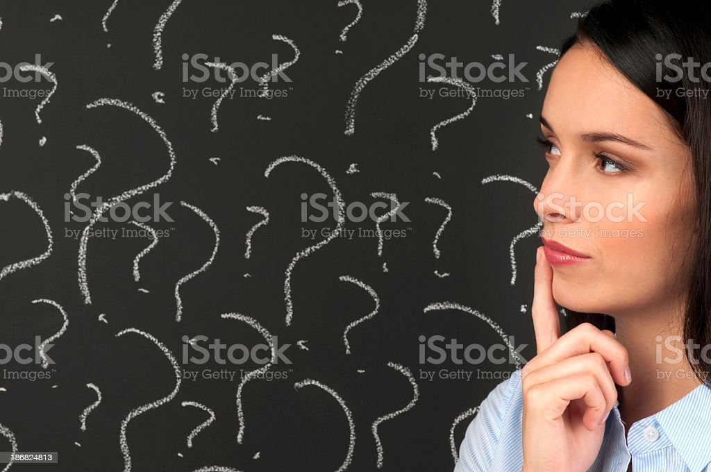Woman contemplating question marks royalty-free stock photo