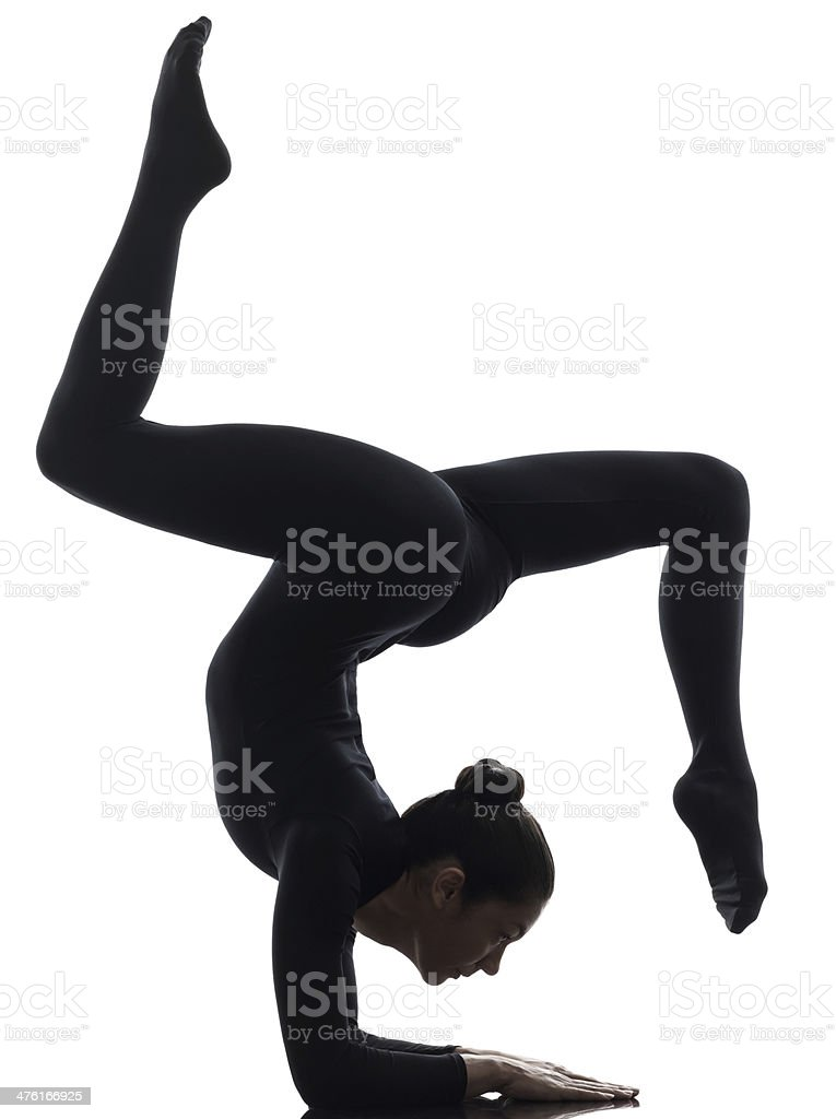 woman contorsionist  exercising gymnastic yoga   silhouette stock photo
