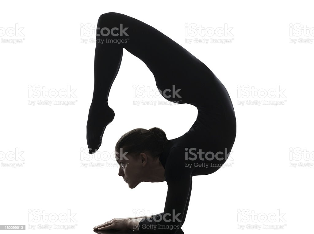 woman contortionist exercising gymnastic yoga silhouette stock photo