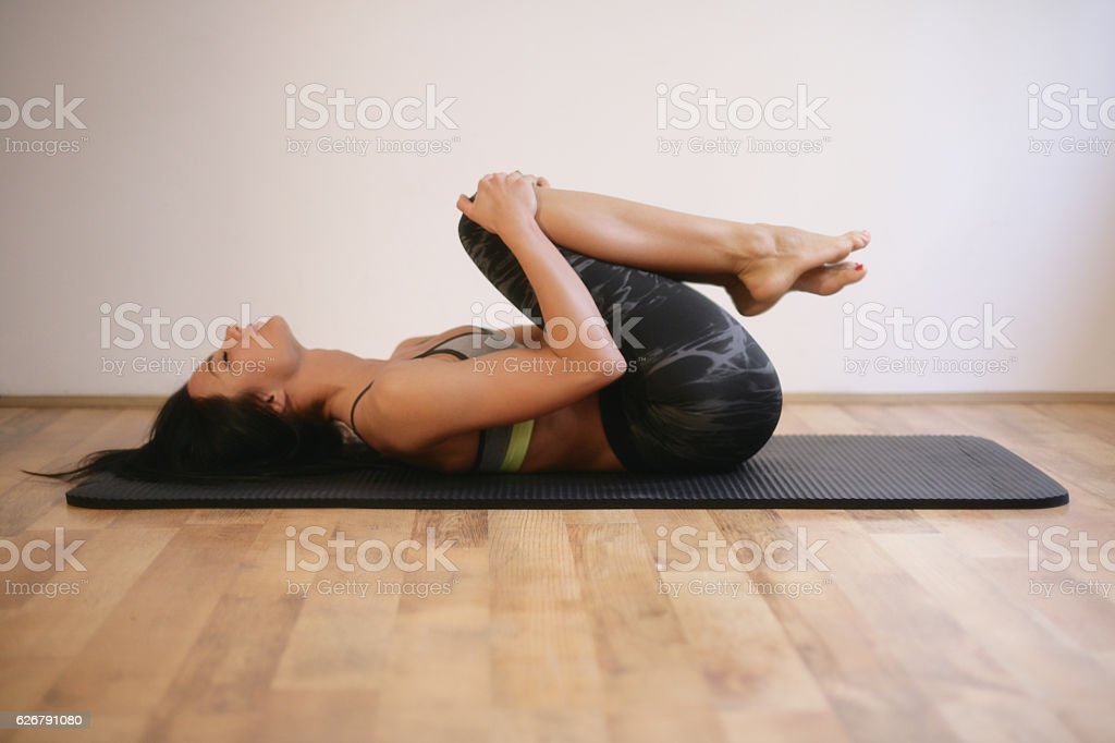 Woman contracting her legs stock photo