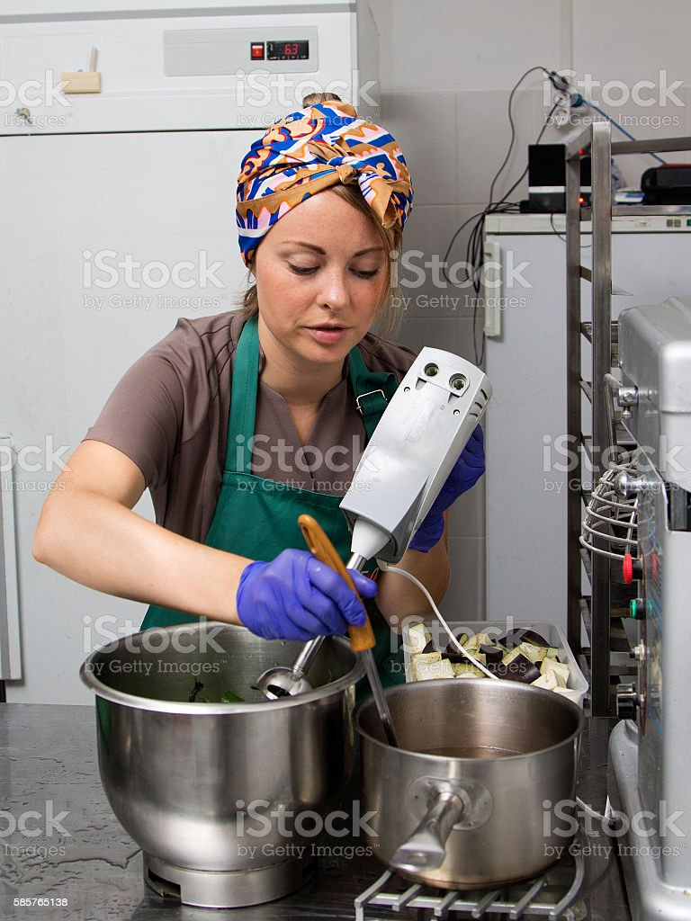 Woman cook working stock photo