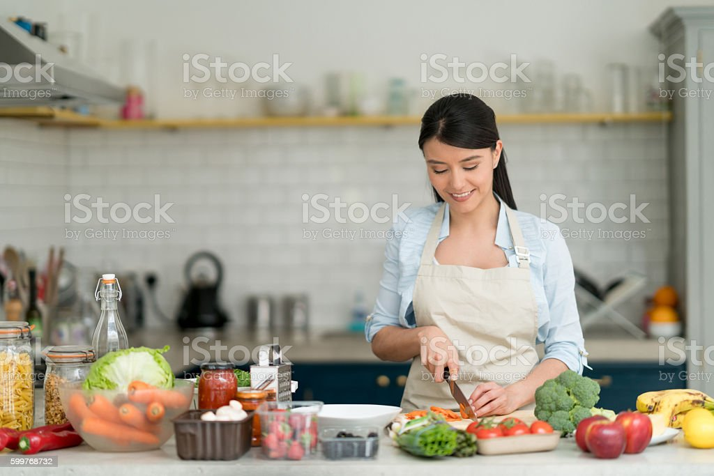 Woman cooking at home stock photo