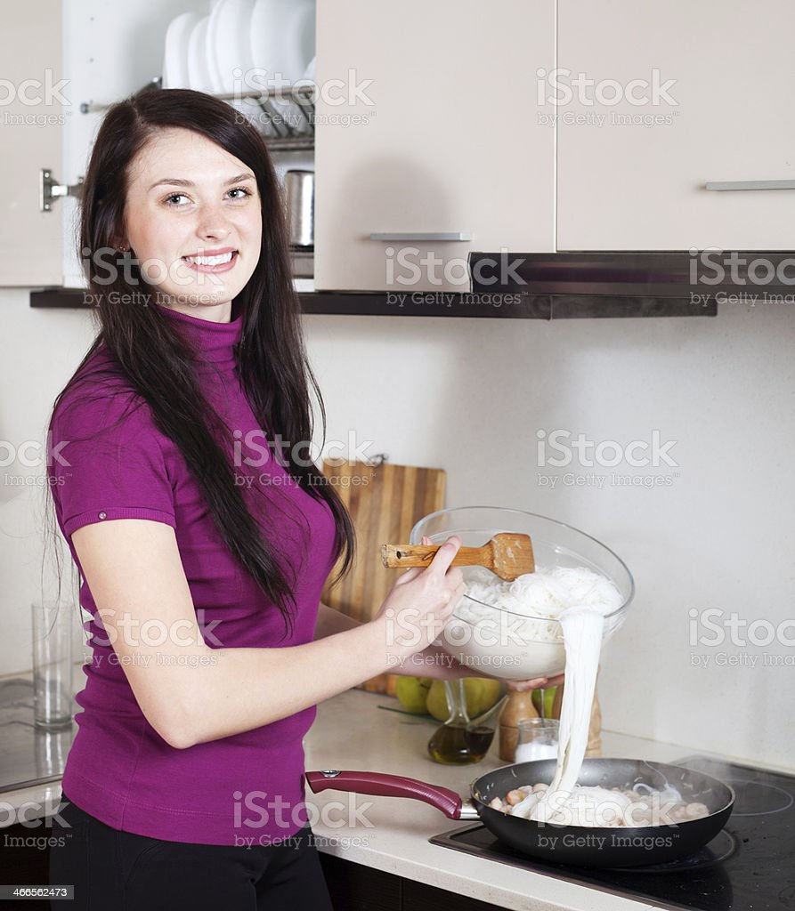 Woman cooking chinese noodles with seafood royalty-free stock photo