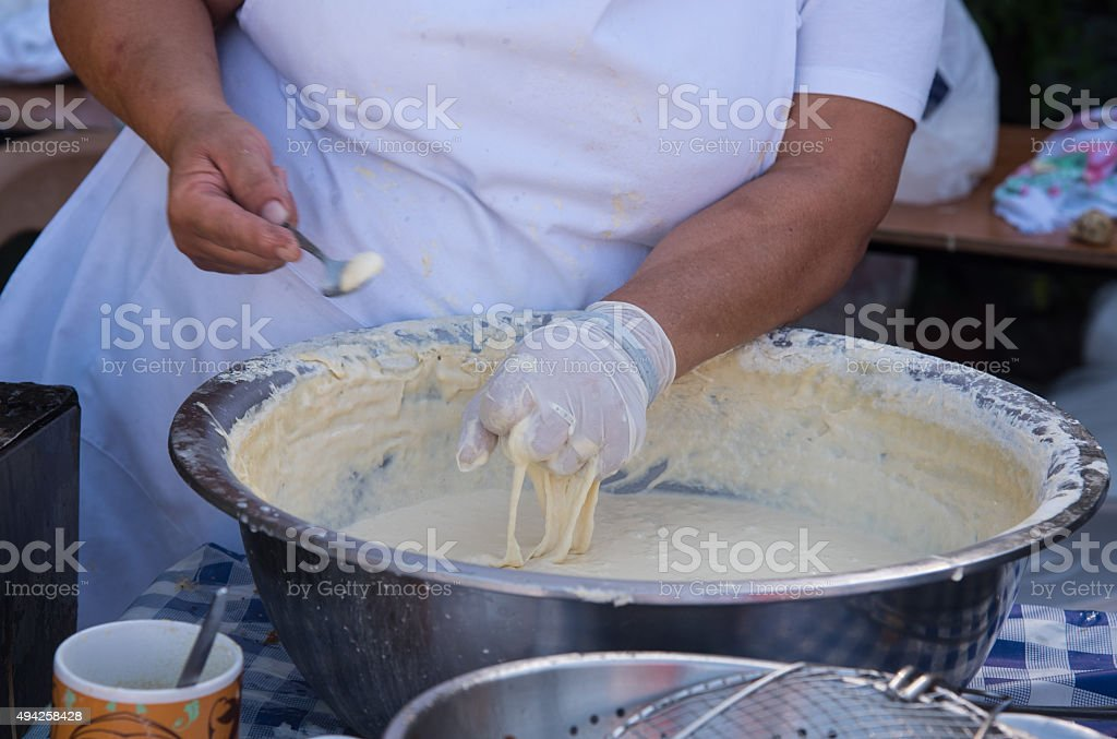Woman cooking delicious  loukoumades pastry stock photo
