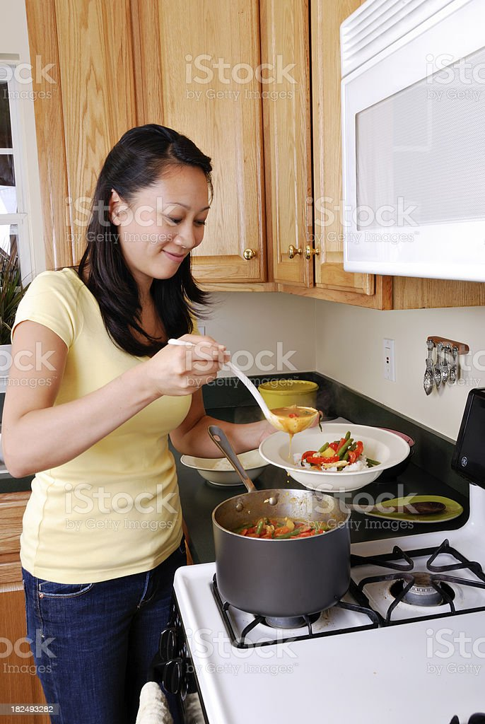 Woman Cooking Dinner royalty-free stock photo