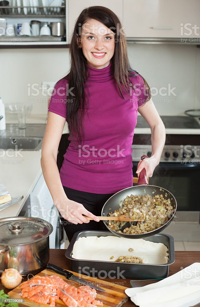 woman cooking fish pie with salmon and vegetables stock photo