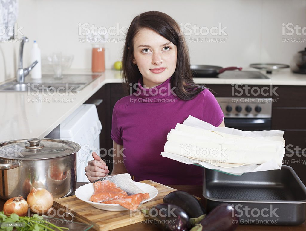 Woman cooking fish pie with  store-bought dough stock photo