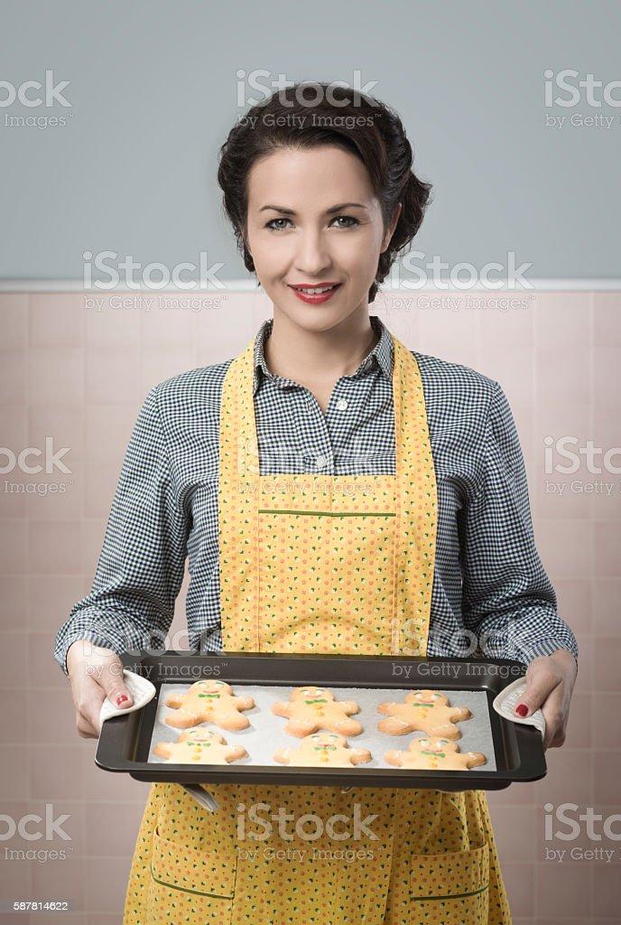 Woman cooking gingerbread men stock photo