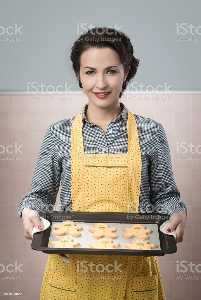Woman cooking gingerbread men stock photo