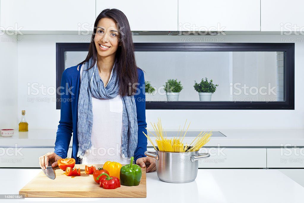 Woman cooking in a modern kitchen. royalty-free stock photo