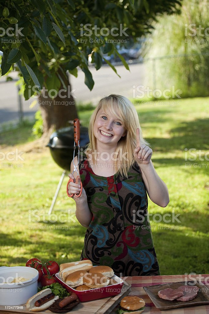 Woman cooking on barbecue royalty-free stock photo