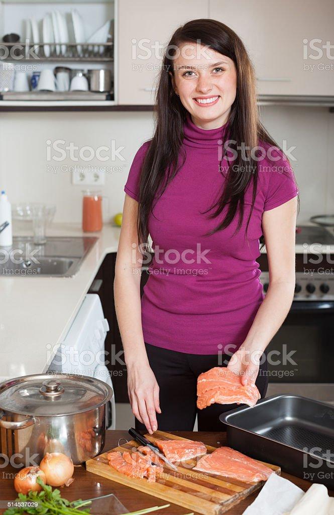 woman cooking  salmon fish stock photo