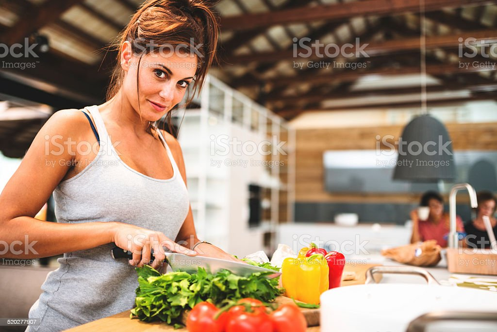 woman cooking vegan in the kitchen stock photo
