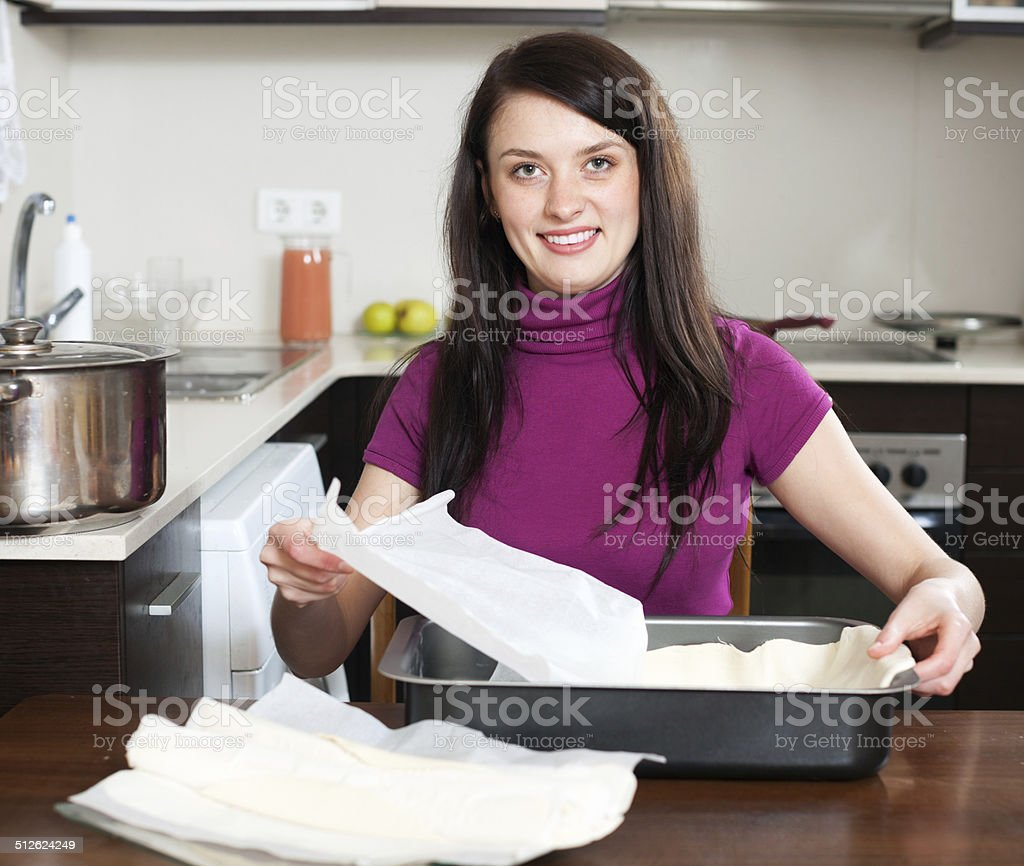 Woman cooking with  dough stock photo