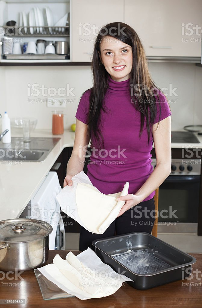 Woman cooking with prepared shop-bought dough stock photo
