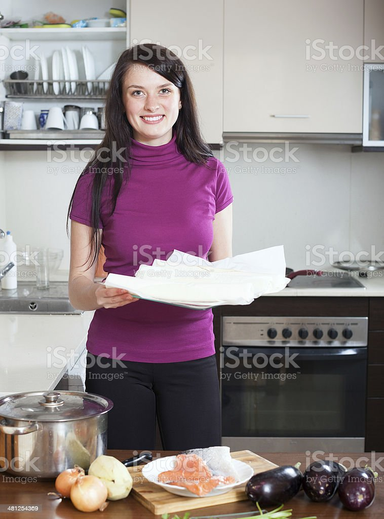woman cooking  with prepared store-bought dough stock photo
