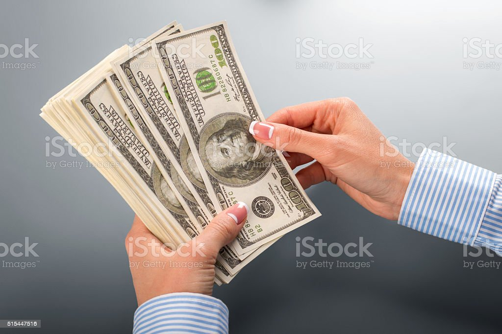 Woman counting bunch of dollars. stock photo