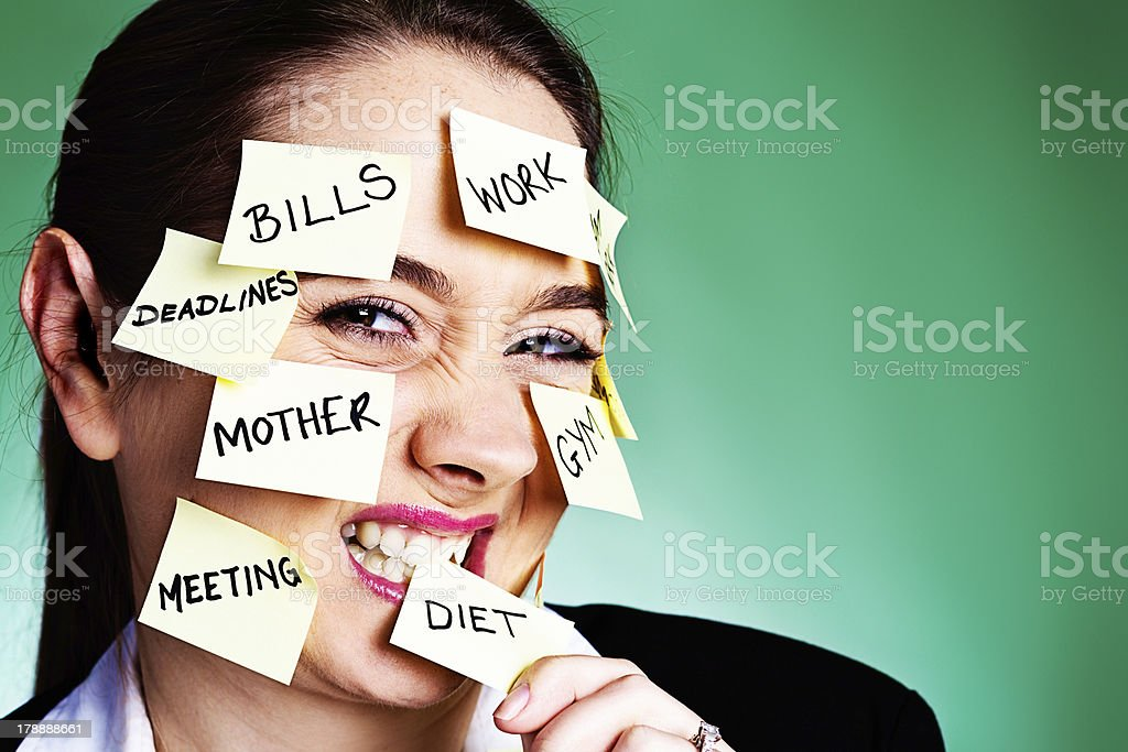 Woman covered in reminders bites one labeled DIET royalty-free stock photo