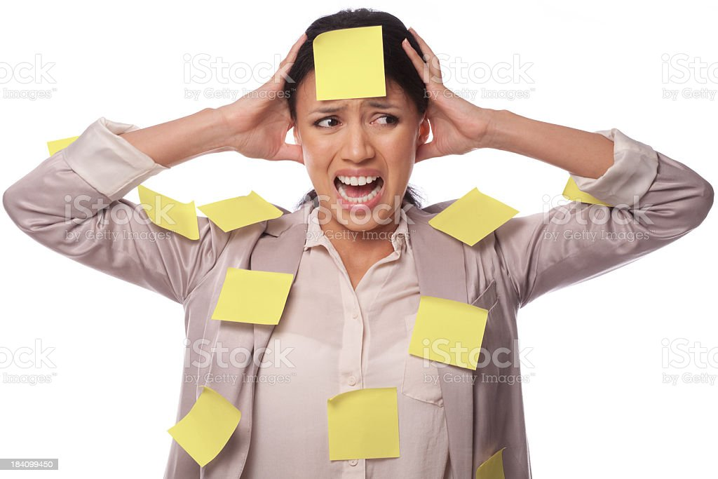 A woman covered with post its looking stressed out royalty-free stock photo