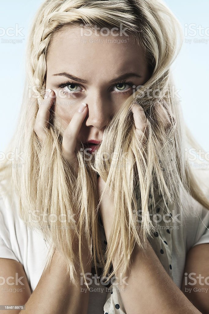 Woman covering her face with hair royalty-free stock photo