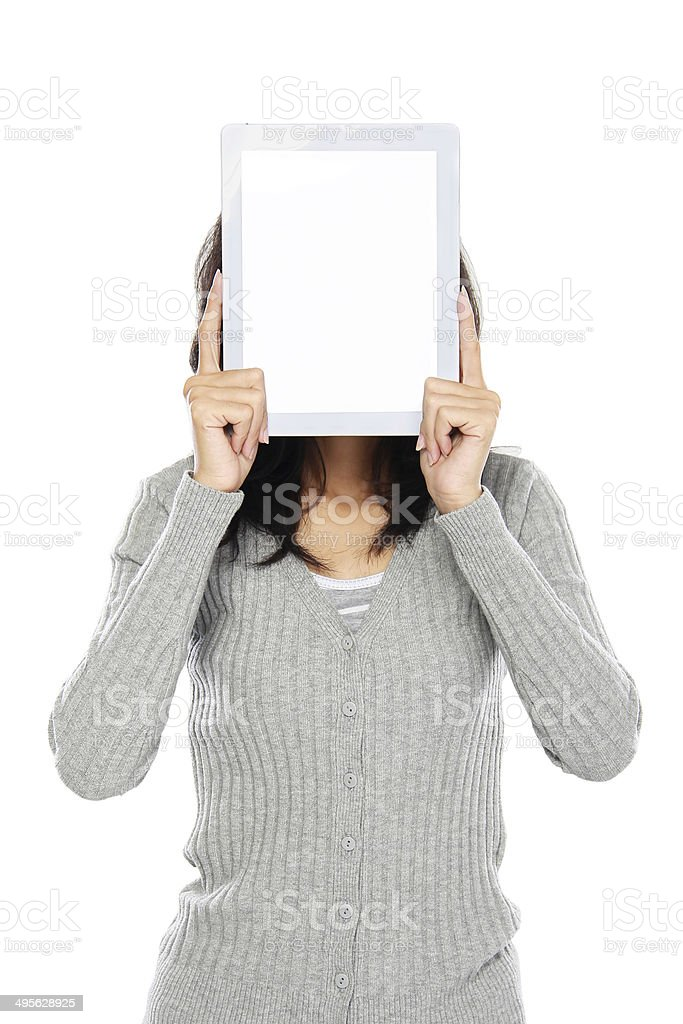 Woman covering her face with tablet computer stock photo