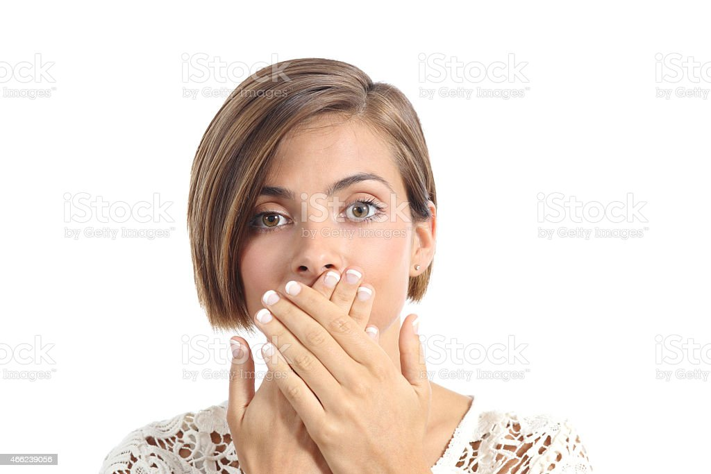 Woman covering her mouth because bad breath stock photo