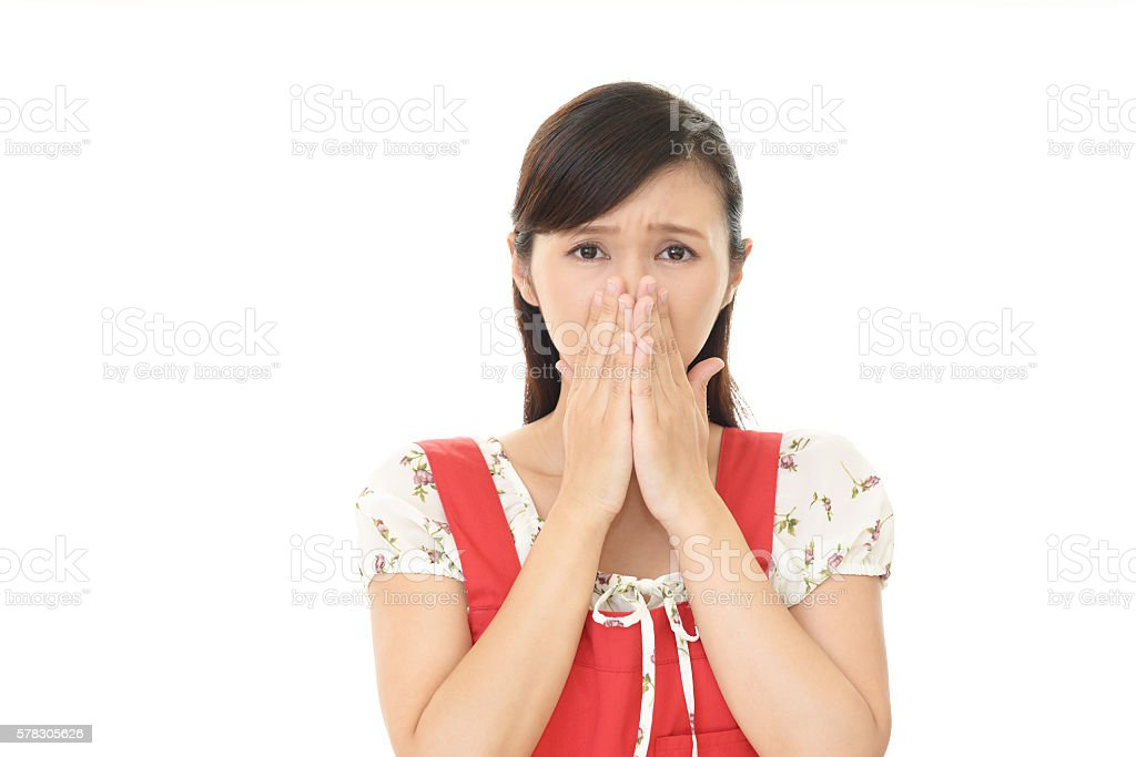Woman covering her nose stock photo