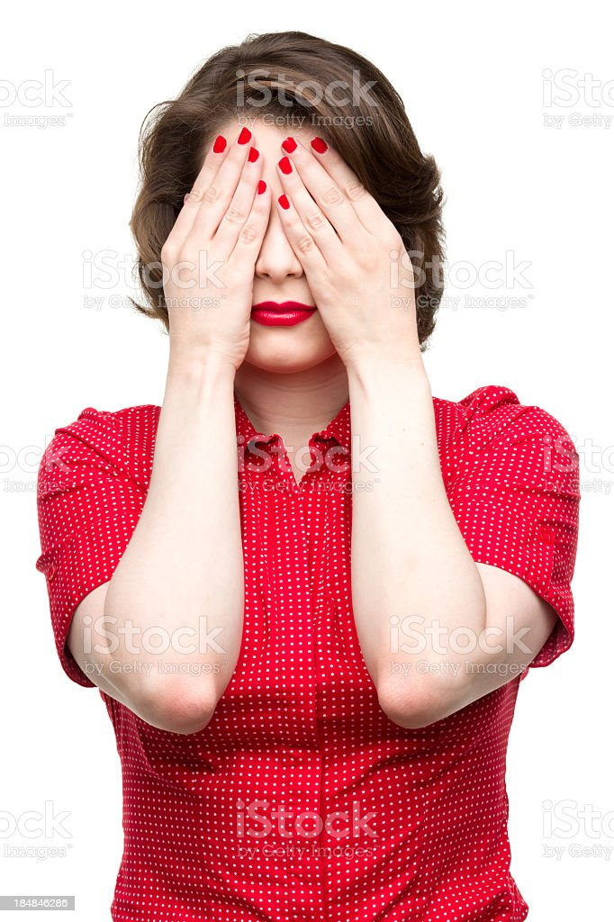Woman Covers Face With Hands stock photo