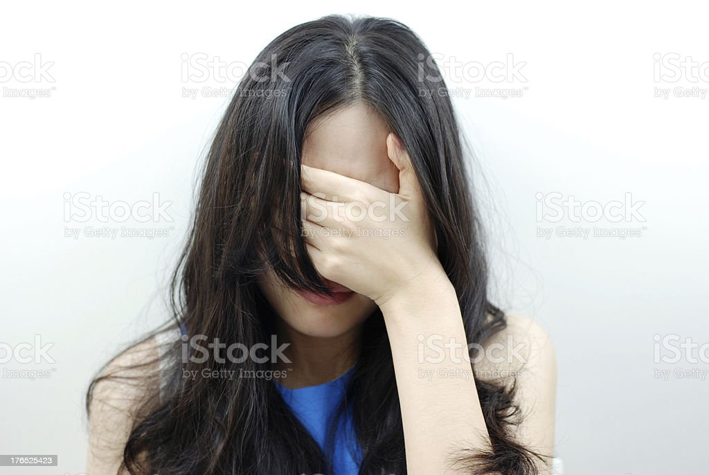 woman covers her face with hand royalty-free stock photo