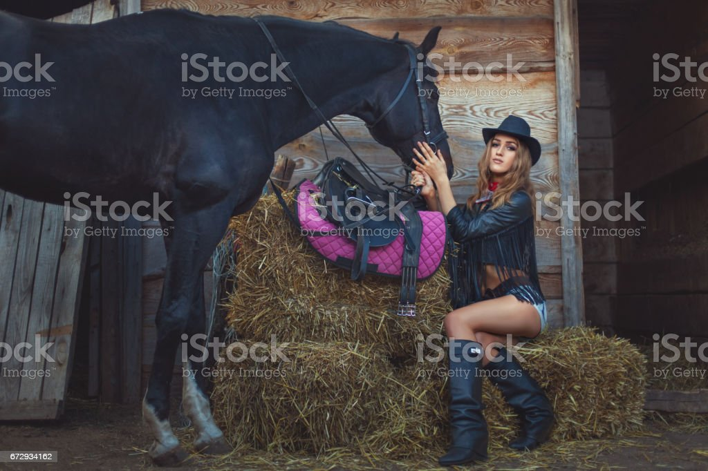 Woman cowboy with a horse. stock photo