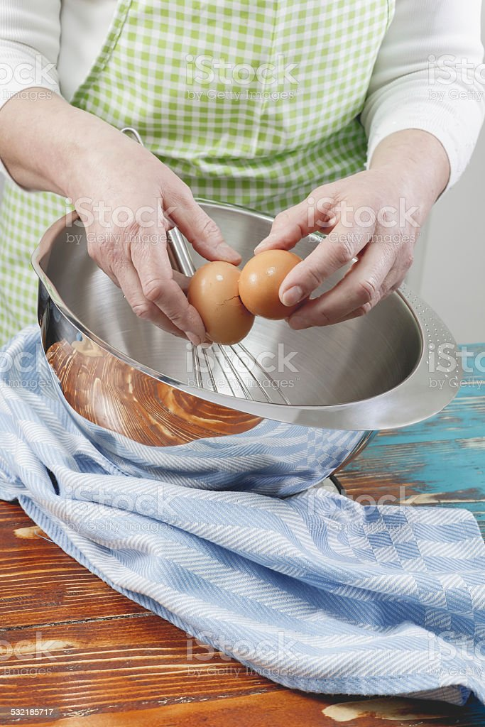 Woman Cracking Egg stock photo