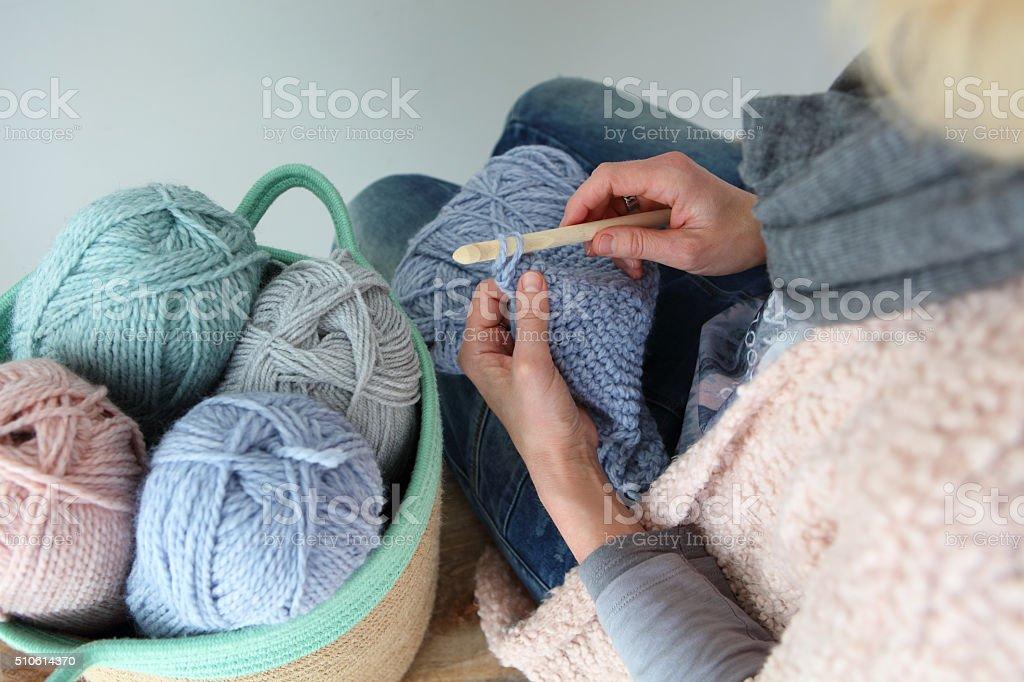Woman Crocheting High Angle View stock photo