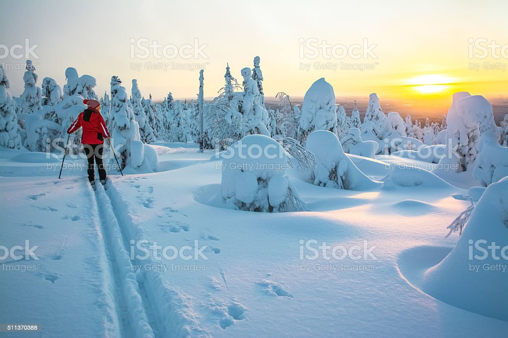 Woman cross country skiing stock photo