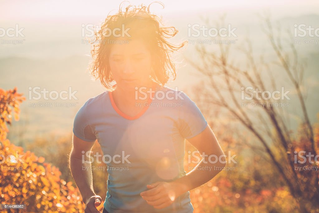 Woman Cross-Country Mountain Running in Julian Alps, Autumn, Europe stock photo